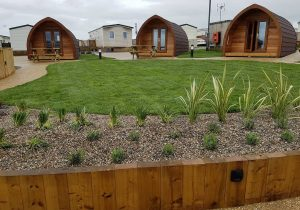 An image of a landscaping job we did with paving and sheds through a modern complex