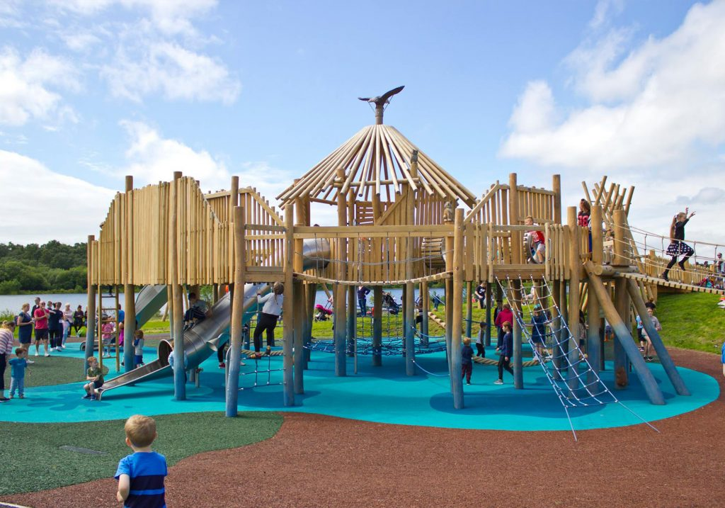 An image of a large play area we created with a huge custom jungle gym