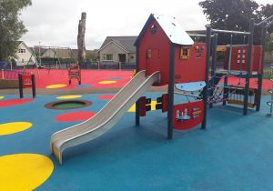 An Image of a play area with a small jungle gym and a slide we created